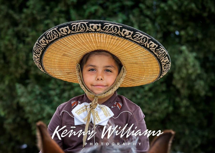 Portrait of Mexican Boy wearing Sombrero Hat, Kent Cornucopia Days, Kent, Washington State, WA, USA.