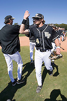 Evan Ocheltree (4) celebrates with teammates following the Wake Forest Demon Deacons 5-3 win over the Clemson Tigers during the first game of a double header at Gene Hooks Stadium in Winston-Salem, NC, Sunday, March 9, 2008.
