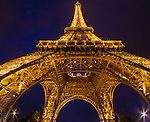 France, Paris.  <br /> Why not experiment and try different vantage points? Under the Eiffel Tower at night, Paris, France. Sometime switching lenses can also help stir your creativity.