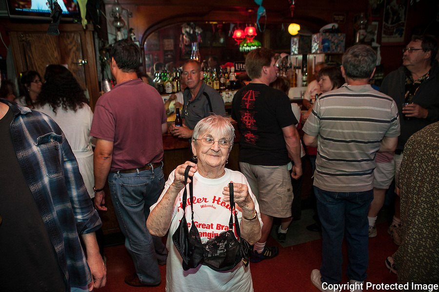Marcy Skowronski, 87, owner of the The Holler House bar in Milwaukee, Wisconsin, began her bar's bra hanging tradtion fouty-five years ago. Skowronski re-establishes the bar's tradition after the city banned her bra hanging practice during the Great Bra Hanging event on June 14, 2013.