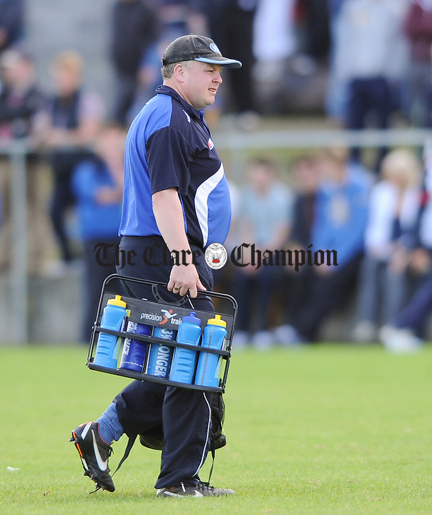 Kilmaley manager John Carmody heads away after playing Clooney-Quin during their senior championship game at Clarecastle. Photograph by John Kelly.