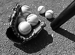 (Tampa, FL, 03/11/15) A collection of baseball spills out from glove along the warming track prior to the start of a Major League Baseball spring training baseball game between the Boston Red Sox and New York Yankees at George M. Steinbrenner Field in Tampa, Florida on Wednesday, March 11, 2015. Photo by Christopher Evans