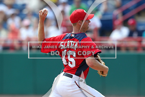 Washington Nationals Doug Slaten #45 delivers a pitch during a spring training game against the Florida Marlins at Spacecoast Stadium on March 27, 2011 in Melbourne, Florida.  Photo By Mike Janes/Four Seam Images
