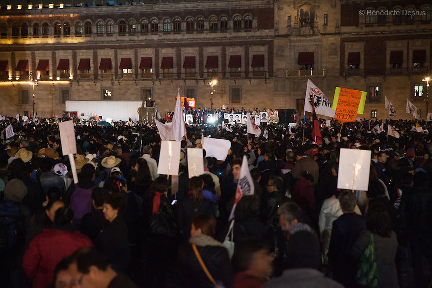 Parents and relatives of the 43 missing students from Ayotzinapa's teacher training college, adress the demonstrators from a platform in front of the National Palace and hold images of the missing students in Mexico City, Mexico on November 20, 2014. Tens of thousand of protesters gather on Zocalo, the city's main square, during a massive march in support of the 43 missing Ayotzinapa's students, on a day normally reserved for the celebration of Mexico's 1910-17 Revolution. Parents of the 43 missing students still do not believe the official line that the young men are all dead. Criticism of the government has intensified in Mexico and the country has been convulsed by protests. Many are demanding justice and that the search for the 43 missing students continue until there is concrete evidence to the contrary. Mexico officially lists more than 20 thousand people as having gone missing since the start of the country's drug war in 2006, and the search for the missing students has turned up other, unrelated mass graves. (Photo by Bénédicte Desrus)
