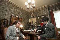 NWA Democrat-Gazette/BEN GOFF @NWABENGOFF<br /> Sean Barrett (left), in costume as Samuel Peel, and Bram Heilmann, in costume as James Berry, pose for a photo while setting up a scene Friday, March 2, 2018, as students from Arkansas Arts Academy film for a project at the Peel Mansion Museum and Heritage Gardens in Bentonville. High school students from the school's audio visual class and theater program are collaborating to produce a 15 minute short film about the Peel Mansion as an entry for the Arkansas Educational Television Network's Student Selects competition for young filmmakers. The film includes interviews with people involved in the museum as well as vignettes of moments in the 1875 home's history with theater students portraying historical figures.