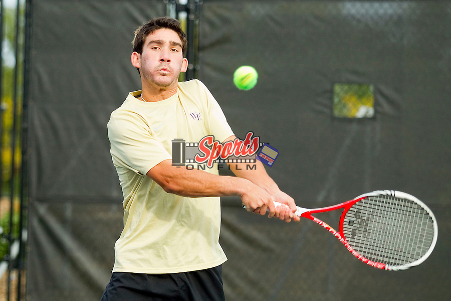 Anthony Delcore of the Wake Forest Demon Deacons returns the ball at the Wake Forest Tennis Center on October 12, 2012 in Winston-Salem, North Carolina.  (Brian Westerholt/Sports On Film)