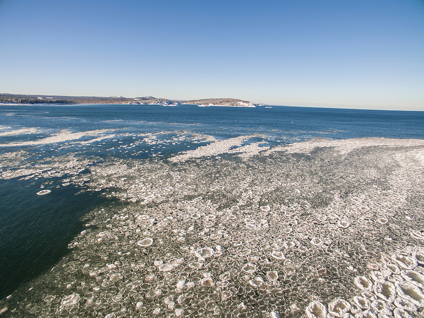 Aerial photo of pancake ice forming on Lake Superior at Presque Isle Park in Marquette, Michigan.