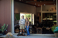 Los Angeles, California, November 14, 2009 - Portrait of Ernie and Diane Wolfe with their dog Malaika  in the backyard of their home, which is based on a Quonset hut. The Wolfe's own the Ernie Wolfe Gallery and are the most reknowned African at dealers in the country. ...CREDIT: Daryl Peveto/LUCEO for The Wall Street Journal.Homefront - Ernie Wolfe #1348.