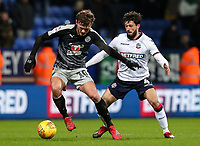 Bolton Wanderers' Jason Lowe competing with Reading's John Swift  <br /> <br /> Photographer Andrew Kearns/CameraSport<br /> <br /> The EFL Sky Bet Championship - Bolton Wanderers v Reading - Tuesday 29th January 2019 - University of Bolton Stadium - Bolton<br /> <br /> World Copyright © 2019 CameraSport. All rights reserved. 43 Linden Ave. Countesthorpe. Leicester. England. LE8 5PG - Tel: +44 (0) 116 277 4147 - admin@camerasport.com - www.camerasport.com