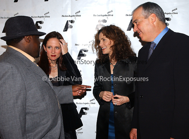 20th Century Fox Presidents Gary Newman and Dana Walden backstage with Amy Brenneman and Cedric The Entertainer at the Los Angeles Free Clinic Dinner Gala  at The Regent Beverly Wilshire Hotel in Beverly Hills ,California on December 2,2002.Photo by Hollywood Press Agency