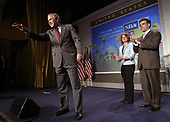 United States President George W. Bush (L) waves goodbye after speaking to the Small Business Administration's National Small Business Week Conference at the Washington Hilton Hotel in Washington, DC on Wednesday, 27 April 2005. With Bush on stage are Small Business Person of the Year Marianne Sensale-Guerin (2R) and Hector Barreto, the SBA Administrator.<br /> Credit: Matthew Cavanaugh / Pool via CNP