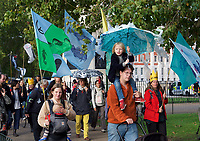 Environmental activists from Extinction Rebellion protest marching in London on 09 October 2019 in London, England.<br /> .<br /> Protesters plan to blockade the London government district for a two week period, as part of 'International Rebellion' taking place in over 60 cities around the world, calling for decisive and immediate action from governments in the face of climate and ecological emergency. <br /> .<br />  Photo by Alan  Stanford.