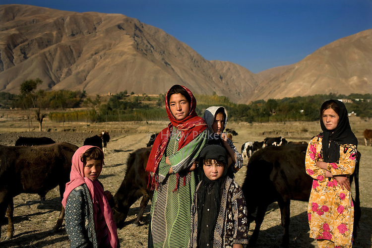 School-age girls pause from their early morning work in Jurm district, Badakhshan province, Afghanistan, Friday morning, Oct. 23, 2009. Many girls in Badakhshan have the opportunity to go to school, some even up to the 9th grade, unusual for rural Afghanistan. As the Obama Administration seeks the formula for turning the tide of the war in Afghanistan, some aid organizations are advocating the National Solidarity Programme, a community-based development program that has made progress in some districts, setting up local councils that propose much-needed projects such as schools, drinking water facilities and roads.