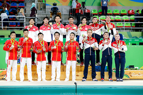 Japan team group (JPN), Russia team group (RUS) China team group (CHN),<br /> AUGUST 8, 2016 - Artistic Gymnastics :<br /> Gold medalists (Top row - L to R) Koji Yamamuro, Kohei Uchimura, Yusuke Tanaka, Kenzo Shirai and Ryohei Kato of Japan, silver medalists (Top row - 6th L to R) Nikita Nagornyy, Nikolai Kuksenkov, (Bottom row - 6th L to R) Ivan Stretovich, David Belyavskiy and Denis Abliazin of Russia and bronze medalists (Bottom row - L to R) Lin Chaopan, Zhang Chenglong, Liu Yang, You Hao and Deng Shudi of China pose with their medals during the Men's Team Medal Ceremony at Rio Olympic Arena during the Rio 2016 Olympic Games in Rio de Janeiro, Brazil. (Photo by Yuzuru Sunada/AFLO)