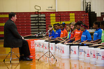 "WATERBURY, CT- 20 November 2014-112014EC02--   Students play ""Bucket Bash,"" a drum performance, as part of the Fall Showcase from members of the Waterbury Symphony's Bravo Waterbury! music program. Hundreds came out to hear the concert in Sacred Heart's gymnasium Thursday night. Erin Covey Republican-American"