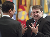 United States Secretary of Veterans Affairs Robert Wilkie, right, in conversation with US Secretary of the Treasury Steven Mnuchin, left, prior to the arrival of US President Donald J. Trump who will make remarks at the Congressional Medal of Honor Society Reception in the East Room of the White House in Washington, DC on Wednesday, September 12, 2018.<br /> CAP/MPI/RS<br /> &copy;RS/MPI/Capital Pictures