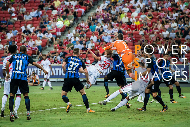 FC Internazionale Goalkeeper Samir Handanovic (C) fights for the ball with Bayern Munich Defender Felix Gotze (L) during the International Champions Cup match between FC Bayern and FC Internazionale at National Stadium on July 27, 2017 in Singapore. Photo by Marcio Rodrigo Machado / Power Sport Images