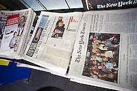 Headlines of the New York Times and the Wall Street Journal report in their Wednesday, January 11, 2012 editions on the results and the winning by former MA Gov. Mitt Romney of the New Hampshire primary on the previous day. The tabloids decided to go with other stories as their front pages.(© Richard B. Levine)