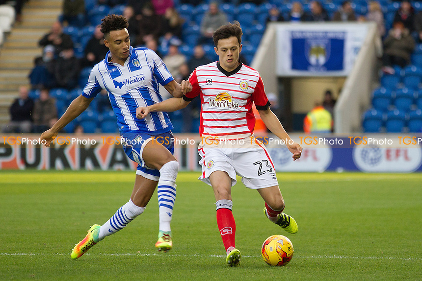 Perry Ng of Crewe Alexandra clears under pressure Kurtis Guthrie of Colchester United during Colchester United vs Crewe Alexandra, Sky Bet EFL League 2 Football at the Weston Homes Community Stadium on 26th November 2016
