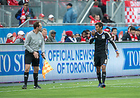 24 March 2012: San Jose Earthquakes forward Chris Wondolowski #8 talks with the referee's assistant Daniel Belleau during a game between the San Jose Earthquakes and Toronto FC at BMO Field in Toronto..The San Jose Earthquakes won 3-0..