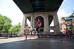 NEW YORK - MAY 8: Bicyclists practice and ride at Coleman Playground under the Manhattan Bridge May 8, 2010 in New York City. (Photo by Donald Bowers)