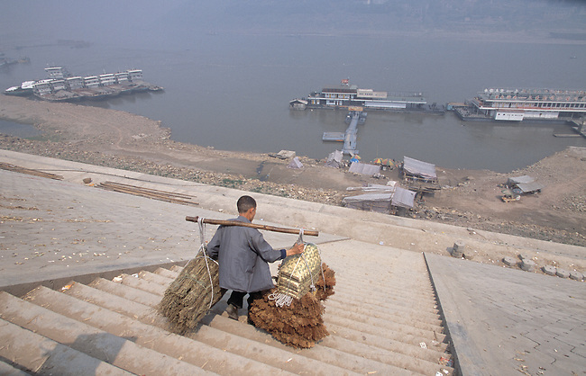 Stick stick man with heavy load on steep stairs; Yangtze River; Fuling, China, Asia; city impacted by 3 Gorges Dam; 041703