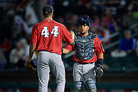 Pawtucket Red Sox pitcher Trevor Kelley (44) and catcher Juan Centeno (2) celebrate closing out an International League game against the Rochester Red Wings on June 28, 2019 at Frontier Field in Rochester, New York.  Pawtucket defeated Rochester 8-5.  (Mike Janes/Four Seam Images)