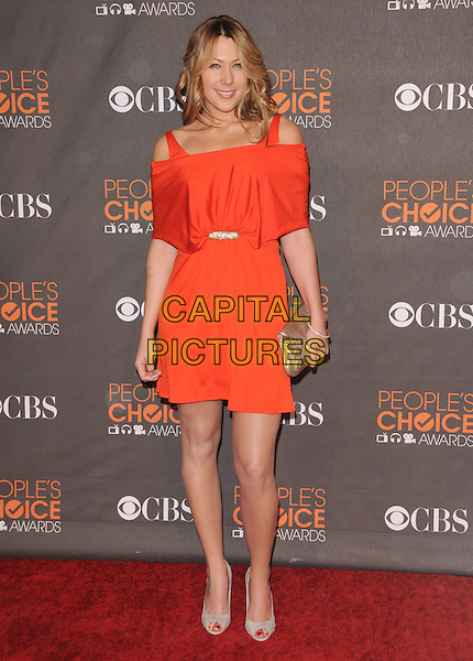 COLBIE CAILLAT.Arrivals at the 2010 People's Choice Awards held at the Nokia Theater L.A. Live in Los Angeles, California, USA. .January 6th, 2010.full length orange red dress cut out shoulders dress coral clutch bag silver gold peep toe shoes .CAP/RKE/DVS.©DVS/RockinExposures/Capital Pictures.