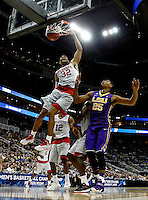 PITTSBURGH, PA - MARCH 19:  Kyle Washington #32 of the North Carolina State Wolfpack dunks the ball against the LSU Tigers in the second half against the LSU Tigers during the second round of the 2015 NCAA Men's Basketball Tournament at Consol Energy Center on March 19, 2015 in Pittsburgh, Pennsylvania.  (Photo by Jared Wickerham/Getty Images)