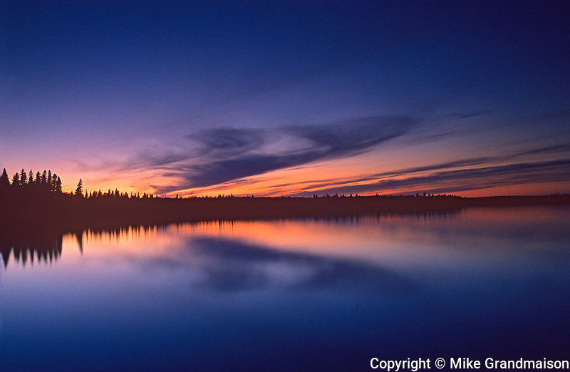 Reflection on Winnipeg River at dawn, Whiteshell Provincial Park, Manitoba, Canada