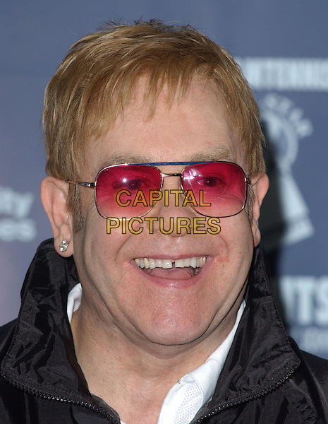 ELTON JOHN .Attends the 12th Annual World Team Tennis Smash Hits Press Conference benefiting The Elton John AIDS Foundation held at The Bren Events Center at UC Irvine in Irvine, California on October 11th 2004..portrait headshot pink sunglasses.Ref: DVS.www.capitalpictures.com.sales@capitalpictures.com.©Debbie VanStory/Capital Pictures .