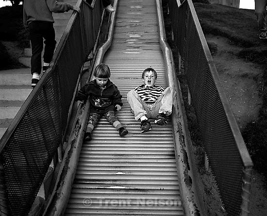 Noah Nelson and some kid on a slide.<br />