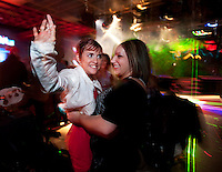 Healthcare advocate Kara Vander Veer dances with her friend and personal assistant Karisa Zuke at Trexx, an alternative lifestyle dance club in downtown Syracuse where she feels comfortable being herself.   Photo by James R. Evans ©