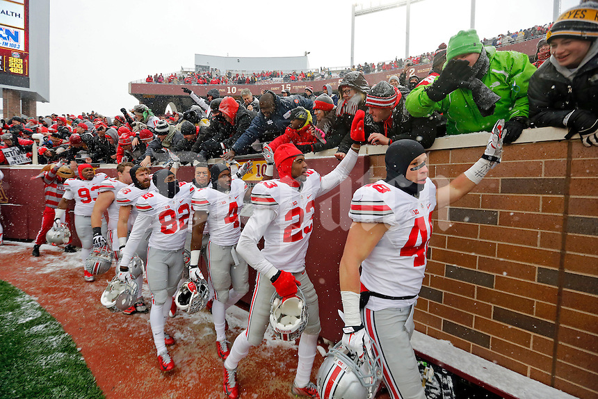 Ohio State Buckeyes players celebrate with fans after beating Minnesota Golden Gophers at TCF Bank Stadium in Minneapolis, Minn. on November 15, 2014.  (Dispatch photo by Kyle Robertson)