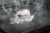 ICE MELTS &amp; VAPORIZES QUICKLY ON HOT GRIDDLE<br /> (Variations Available)<br /> Three States of Matter - Ice, Water &amp; Vapor<br /> 720 cal/gram is needed to first melt the solid, then vaporize the liquid water. The energy is absorbed by individual molecules of water to break the H bonds holding the crystal together resulting in a liquid then a gas.