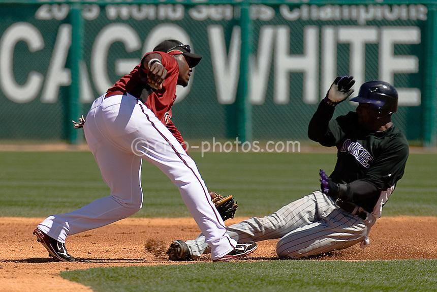 Mar 22, 2008; Tucson, AZ, USA; Arizona Diamondbacks second baseman Orlando Hudson (1) tags out Colorado Rockies center fielder Willy Taveras (3) trying to steal second base in the top of the 2nd inning of a game between the Colorado Rockies and Arizona Diamondbacks at Tucson Electric Park.  The Rockies would win the game 12-11.