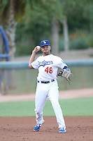 Jared Walker (48) of the AZL Dodgers makes a throw during a game against the AZL Diamondbacks at the Los Angeles Dodgers Spring Training Complex on July 3, 2015 in Glendale, Arizona. Diamondbacks defeated the Dodgers, 5-1. (Larry Goren/Four Seam Images)