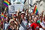 © Joel Goodman - 07973 332324 - all rights reserved . 03/07/2010 . London , UK . People on the march gesture towards evangelical Christians who protest the event . Annual London Pride march and demonstration through the centre of London . Photo credit : Joel Goodman