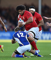 Opeti Fonua of Tonga looks to get past Johan Deysel of Namibia. Rugby World Cup Pool C match between Tonga and Namibia on September 29, 2015 at Sandy Park in Exeter, England. Photo by: Patrick Khachfe / Onside Images