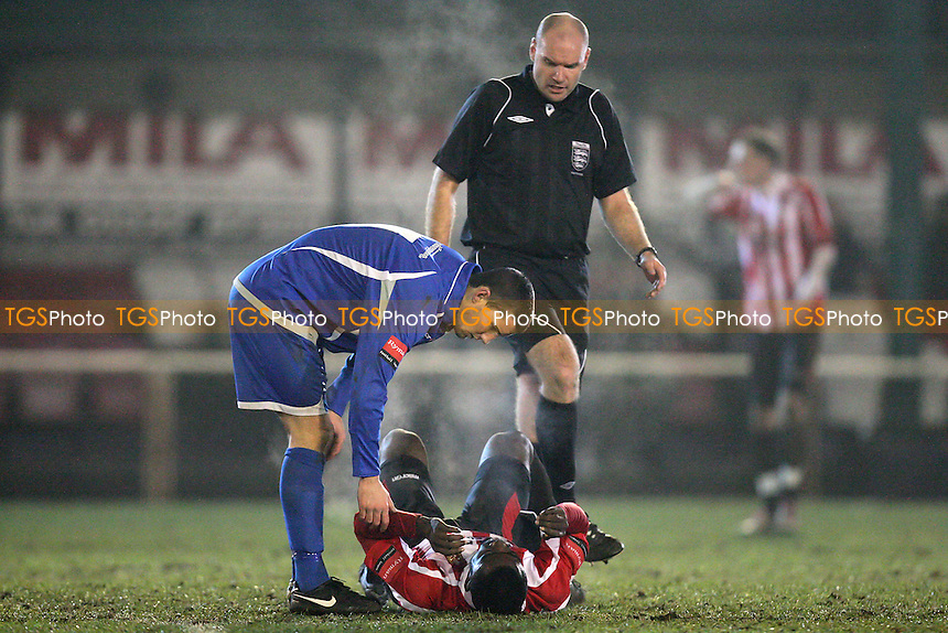 Tambeson Eyong of Hornchurch goes down with an injury - AFC Hornchurch vs Margate - Ryman League Premier Division Football at The Stadium - 01/02/11 - MANDATORY CREDIT: Gavin Ellis/TGSPHOTO - Self billing applies where appropriate - Tel: 0845 094 6026