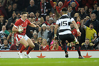 Wales Josh Adams takes on Barbarians Shaun Stevenson<br /> <br /> Photographer Ian Cook/CameraSport<br /> <br /> 2019 Autumn Internationals - Wales v Barbarians - Saturday 30th November 2019 - Principality Stadium - Cardifff<br /> <br /> World Copyright © 2019 CameraSport. All rights reserved. 43 Linden Ave. Countesthorpe. Leicester. England. LE8 5PG - Tel: +44 (0) 116 277 4147 - admin@camerasport.com - www.camerasport.com