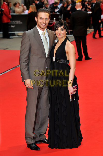 MATT DI ANGELO & FLAVIA CACACE.Red Carpet Arrivals for the British Academy Television Awards 2008, held at the London Palladium, London, England, April 20th 2008. .BAFTA BAFTA's full length brown suit tie black halterneck dress .CAP/PL.©Phil Loftus/Capital Pictures
