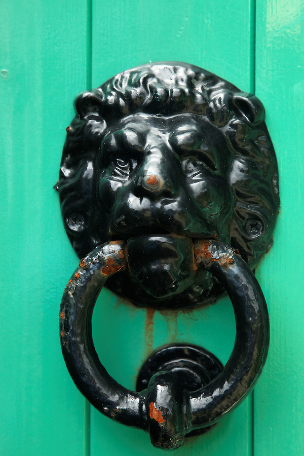 Lion door knocker on green door, Glenveagh Castle, Glenveagh National Park, County Donegal, Republic of Ireland