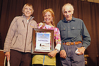 Thursday February 28, 2013  DeeDee Jonrowe (center) presents the Iditarod Trail Founders Award to Joe and Norma Delia, longtime checkers at Skwentna at the musher drawing banquet held at the Dena'ina Convention Center in Anchorage two days prior to the start of Iditarod 2013...Photo (C) Jeff Schultz/IditarodPhotos.com  Do not reproduce without permission.