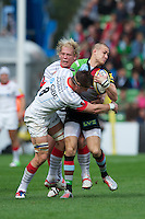 Mike Brown of Harlequins is tackled by Ernst Joubert and Petrus du Plessis of Saracens during the Aviva Premiership match between Harlequins and Saracens at the Twickenham Stoop on Sunday 30th September 2012 (Photo by Rob Munro)