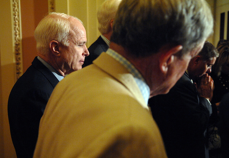 Sen. John McCain, R-Ariz., attends a briefing with the press after the senate luncheons.  Sens. Kit Bond, R-Mo., center, and Lindsey Graham, R-S.C., right, also appear.