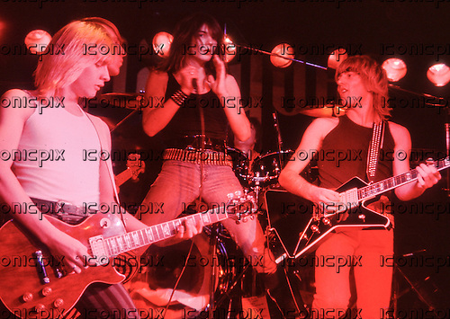 GIRL - L-R: Gerry Laffy, Phil Lewis, Phil Collen - performing live at the Marquee Club in London UK - Apr 1980.  Photo credit: George Chin/IconicPix