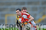 Eoin Lawlor Rathmore is stopped by Currow Seamus Brosnan during their O'Donoghue cup semi final in Fitzgerald Stadium on Sunday