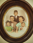 John and Eleanor Miller family color tinted portrait in oval frame. 1950's