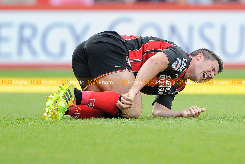 Yann Kermorgant of AFC Bournemouth goes down injured - AFC Bournemouth vs Southampton - Pre-Season Friendly Football Match at the Goldsands Stadium, Kings Park, Boscombe, Bournemouth, Dorset - 25/07/14 - MANDATORY CREDIT: Denis Murphy/TGSPHOTO - Self billing applies where appropriate - contact@tgsphoto.co.uk - NO UNPAID USE